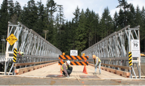 Workers at the John Hart Dam generating station replacement project put the final touches on the new Brewster Lake Road bridge for construction traffic.