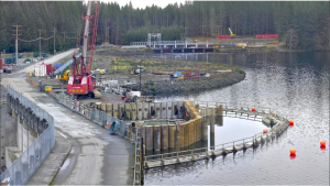 This photo from BC Hydro shows construction on the cofferdam, an important step in the overall replacement project. This will be the site of the new water intake.
